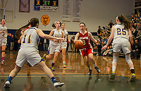 Helen Tautkus dribbles the ball down through Gilford's defense during Friday night basketball at Gilford High School.  (Karen Bobotas/for the Laconia Daily Sun)