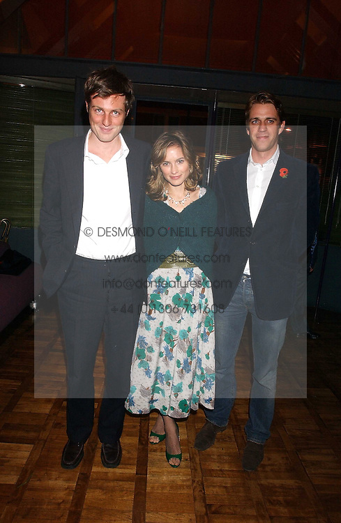 Left to right, ZAC GOLDSMITH, his wife SHEHERAZADE and BEN ELLIOT at a party to celebrate the publication of 'E is for Eating' by Tom Parker Bowles held at Kensington Place, 201 Kensington Church Street, London W8 on 3rd November 2004.<br />