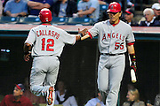 Sept. 15, 2010; Cleveland, OH, USA; Los Angeles Angels third baseman Alberto Callaspo (12) is congratulated by designated hitter Hideki Matsui (55) after he crossed home plate during the second inning  against the Cleveland Indians at Progressive Field. Mandatory Credit: Jason Miller-US PRESSWIRE