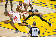 Golden State Warriors guard Shaun Livingston (34) has the ball stripped by the Houston Rockets defense during Game 4 of the Western Conference Finals at Oracle Arena in Oakland, Calif., on May 22, 2018. (Stan Olszewski/Special to S.F. Examiner)