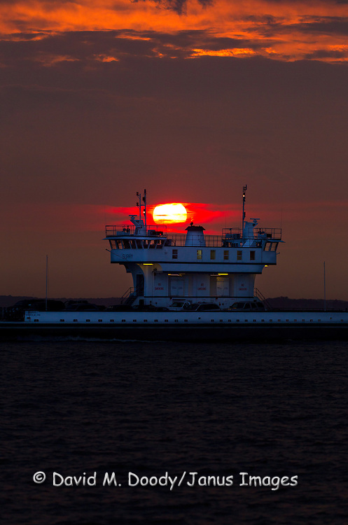 "The Ferry boat ""Surry"" crossing in front of the setting summer sun. Jamestown-Scotland Ferry across the James River at sunset.  Surry to James City County, Williamsburg, Virginia. This portion of the James River is tidal and is part of the Chesapeake Bay Watershed."