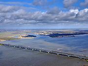 Nederland, Zuid-Holland, Hollands Diep, 25-02-2020; Hollandsch Diep, de grens tussen Brabant en Zuid-Holland met spoorbruggen: HSL-brug en de Moerdijkspoorbrug. Dordtsche Biesbosch in de achtergrond.<br /> Railwaybridges across Hollandsch Diep.<br /> <br /> luchtfoto (toeslag op standard tarieven);<br /> aerial photo (additional fee required)<br /> copyright © 2020 foto/photo Siebe Swart