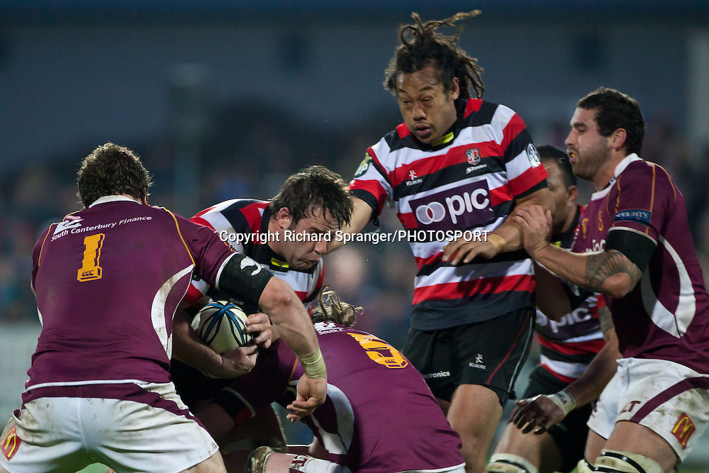 Tana Umaga arrives to support Jono Owen as he gets tackled byJamie Mackintosh & Alex Ryan. ITM Cup and Ranfurly Shield rugby union game betwen Southland and Counties Manukau, played at Rugby Park Invercargill, New Zealand, on Saturday 14 August 2010.