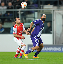 Arsenal's Santi Cazorla and Anderlecht's Anthony Vanden Borre - Photo mandatory by-line: Dougie Allward/JMP - Mobile: 07966 386802 - 22/10/2014 - SPORT - Football - Anderlecht - Constant Vanden Stockstadion - R.S.C. Anderlecht v Arsenal - UEFA Champions League - Group D