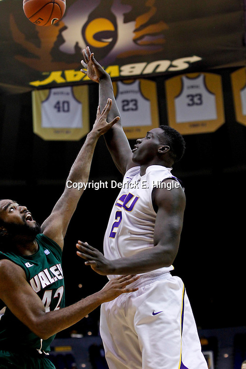 November 24, 2012; Baton Rouge, LA; LSU Tigers forward Johnny O'Bryant III (2) shoots over Mississippi Valley State Delta Devils forward Jason Holmes (42) during the first half of a game at the Pete Maravich Assembly Center.  Mandatory Credit: Derick E. Hingle-US PRESSWIRE
