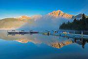 Pyramid Lake in fog at sunrise<br /> Jasper National Park<br /> Alberta<br /> Canada