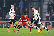 Derby County midfielder Tom Ince (10) battles with Bristol City defender Scott Golbourne (13) during the EFL Sky Bet Championship match between Derby County and Bristol City at the Pride Park, Derby, England on 11 February 2017. Photo by Jon Hobley.