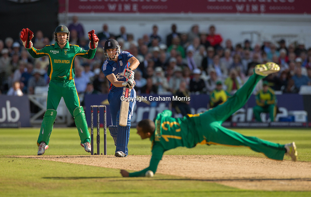 Robin Petersen drops Chris Woakes off his own bowling as wicket keeper/captain AB de Villiers watches during the fifth and final NatWest Series one day international between England and South Africa at Trent Bridge, Nottingham. Photo: Graham Morris (Tel: +44(0)20 8969 4192 Email: sales@cricketpix.com) 05/09/12