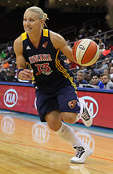 June 3, 2012; Newark, NJ, USA; Indiana Fever guard Erin Phillips (13) dribbles the ball during the second half at the Prudential Center. The Liberty defeated the Fever 87-72.