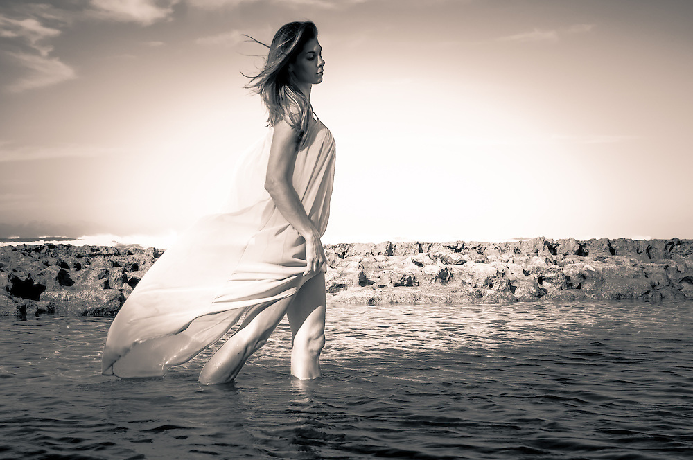 Woman wading there water in long dress B&W