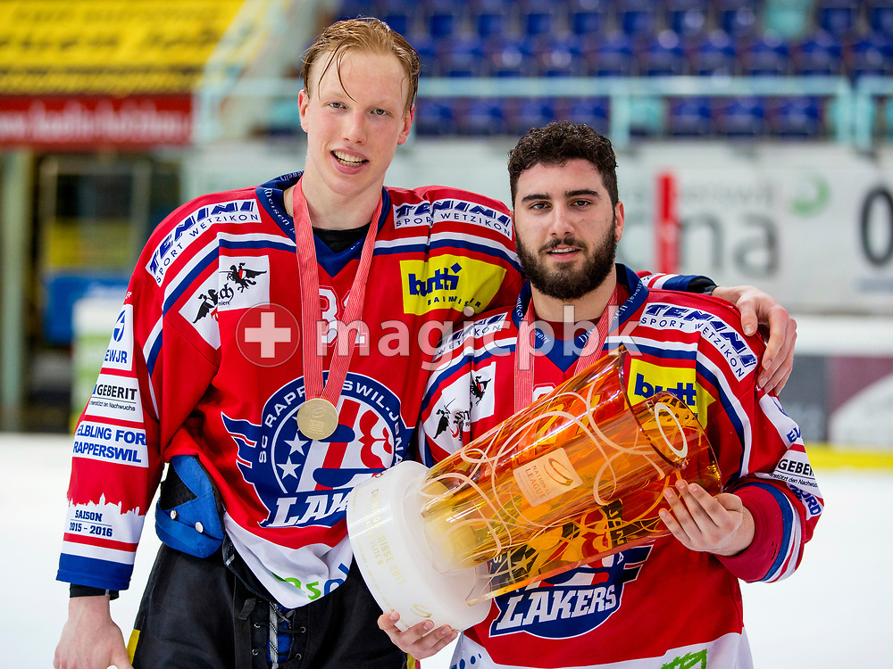 (L-R) Rapperswil-Jona Lakers forward Ryhor Ustsimenka and Elia Auriemma pose for a photo with his gold medal and the Swiss Championships trophy after winning the fifth Elite B Playoff Final ice hockey game between Rapperswil-Jona Lakers and ZSC Lions held at the SGKB Arena in Rapperswil, Switzerland, Sunday, Mar. 19, 2017. (Photo by Patrick B. Kraemer / MAGICPBK)