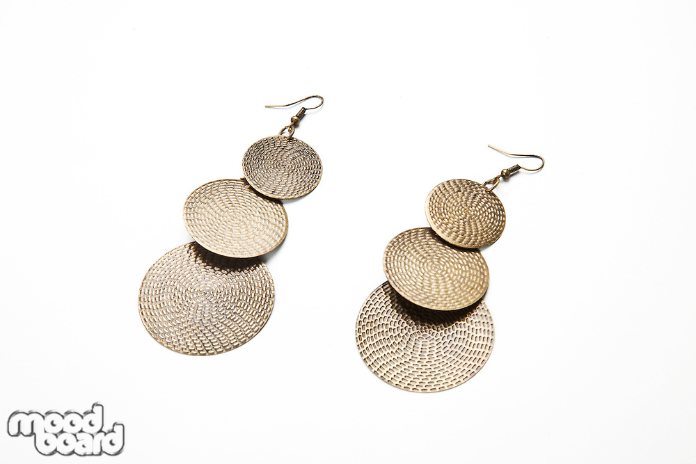 Traditional earrings over white background