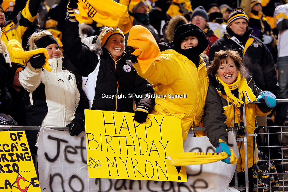 Pittsburgh Steelers fans wave terrible towels, hold up a happy birthday sign for deceased Steelers announcer Myron Cope, and cheer during the NFL 2011 AFC Championship playoff football game against the New York Jets on Sunday, January 23, 2011 in Pittsburgh, Pennsylvania. The Steelers won the game 24-19. (©Paul Anthony Spinelli)