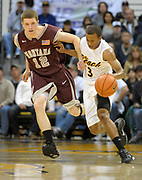 Feb 19, 2011; Long Beach, CA, USA; Long Beach State guard Greg Plater (3) is defended by Montana Grizzlies guard Jordan Wood (12) at the Walter Pyramid. Long Beach State defeated Montana, 74-56.
