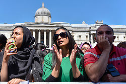 © Licensed to London News Pictures. 02/07/2017. London, UK. People celebrate the EID Festival in Trafalgar Square, an event hosted by The Mayor of London.  The Mayor's festival takes place in the square one week after the end of Ramadan and includes a variety of stage performances and cultural activities. Photo credit : Stephen Chung/LNP