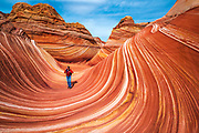 Hiker at The Wave, Coyote Buttes, Paria-Vermilion Cliffs Wilderness, Arizona USA