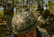 Airman Joshua Long demonstrates how members of the 437th Security Forces protect their facility at Charleston Charleston Air Force Base, S.C., on Oct. 30, 2008.