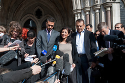 © Licensed to London News Pictures. 30/03/2012. London, UK.  Family of Anni Dewani L to R Anish Hindocha (Brother) Ami Denborg (Sister) Vinod Hindocha (Father) speaking to the media on the steps of The High Court on March 30, 2012 where a judge temporarily halted British businessman Shrien Dewani's extradition to South Africa on mental health grounds. Shrien Dewani, is accused of arranging the contract killing of wife Anni in Cape Town in November 2010. Photo credit : Ben Cawthra/LNP