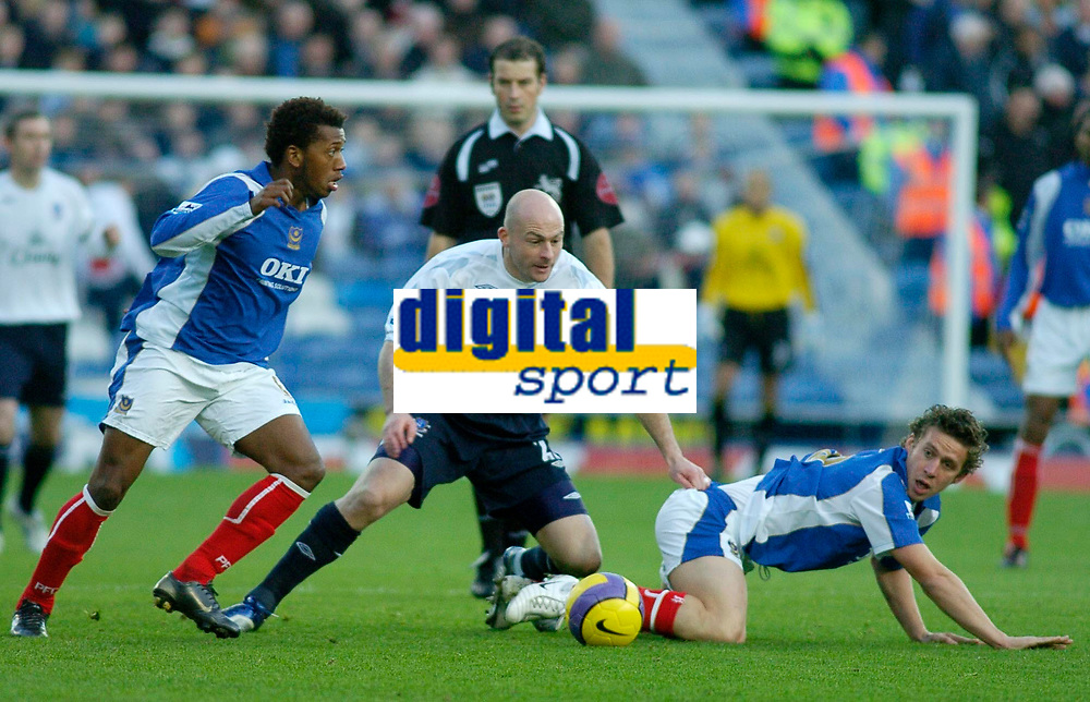 Photo: Gareth Davies.<br />Portsmouth v Everton. The Barclays Premiership. 09/12/2006.<br />Everton's Lee Carsley (C) takes on two of the Portsmouth midefielders.
