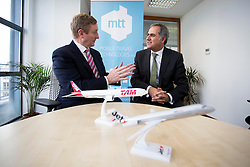 FAO Tom Lyons <br /> - Repro Free: 20/02/2014<br /> An Taoiseach, Enda Kenny TD, is pictured at the opening of Mobile Travel Technologies Ltd (MTT) new office at Grand Canal Dublin, with Gerry Samuels, CEO, MTT, as it expand it&rsquo;s sophisticated mobile solutions business. Picture Andres Poveda