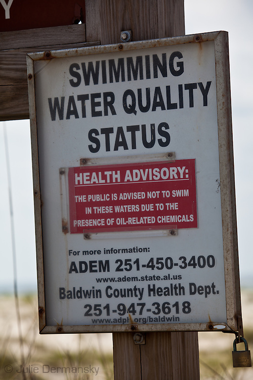 Warning sign at Bon Secour National Wildlife Refuge warning against swimming.  Oil  from the BP oil spill washed  on shore  at Bon Secour National Wildlife Refuge, Alabama on June 12, 2010 .