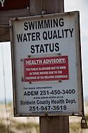 Warning sign at Bon Secour National Wildlife Refuge warning against swimming.  Oil  from the BP oil spill washed  on shore  at Bon Secour National Wildlife Refuge, Alabama on June 12, 2010 .