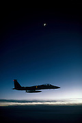 F-15 Eagle jet fighter silhouetted as night falls