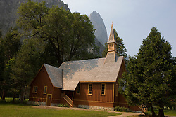 Yosemite Chapel with Cathedral Rocks in the background, Yosemite National Park, California, USA.