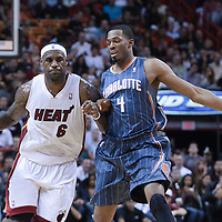 19 November 2010: Miami Heat's small forward #6 LeBron James brings the ball upcourt past Charlotte Bobcats' forward #4 Derrick Brown during the Miami Heat 95-87 victory over the Charlotte Bobcats at the AmericanAirlines Arena, Miami, Florida, USA.