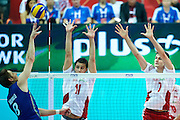 Poland's Fabian Drzyzga (centre)and Karol Klos (right) defend against Brazil's Murilo Endres (left) while volleyball final match between Brazil and Poland during the 2014 FIVB Volleyball World Championships at Spodek Hall in Katowice on September 21, 2014.<br /> <br /> Poland, Katowice, September 21, 2014<br /> <br /> For editorial use only. Any commercial or promotional use requires permission.<br /> <br /> Mandatory credit:<br /> Photo by &copy; Adam Nurkiewicz / Mediasport