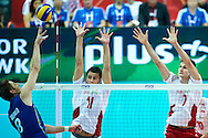 Poland's Fabian Drzyzga (centre)and Karol Klos (right) defend against Brazil's Murilo Endres (left) while volleyball final match between Brazil and Poland during the 2014 FIVB Volleyball World Championships at Spodek Hall in Katowice on September 21, 2014.<br /> <br /> Poland, Katowice, September 21, 2014<br /> <br /> For editorial use only. Any commercial or promotional use requires permission.<br /> <br /> Mandatory credit:<br /> Photo by © Adam Nurkiewicz / Mediasport