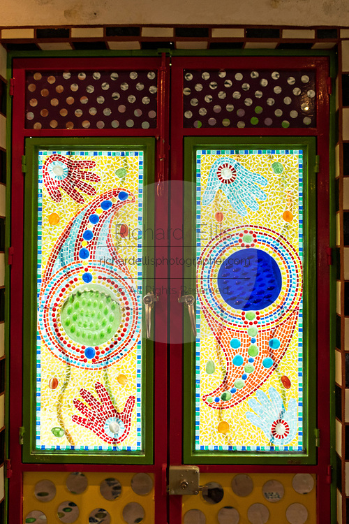 An assemblage glass door at the Chapel of Jimmy Ray by American artist Anado McLauchlin in his compound Casa las Ranas September 28, 2017 in La Cieneguita, Mexico.