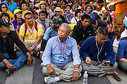 12 MAY 2014 - BANGKOK, THAILAND: SUTHEP THAUGSUBAN and his supporters block Phichai Road near the Parliament building in Bangkok. Several thousand protestors with the People's Democratic Reform Committee (PDRC) blocked access to the Thai Parliament building in Bangkok as a part of their continuing anti-government protests. The Parliament is not currently in session and was dissolved by former Prime Minister Yingluck Shinawatra but the Senate is in session. The protestors are demanding that the Senate dissolve the current Pheu Thai caretaker government and appoint a new Prime Minister and cabinet. Members of the Senate leadership met with Suthep Thaugsuban Monday to discuss the impasse.   PHOTO BY JACK KURTZ