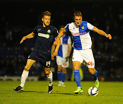 Bristol Rovers' Lee Brown maraudes past Southend United's Kevan Hurst  - Photo mandatory by-line: Seb Daly/JMP - Tel: Mobile: 07966 386802 27/09/2013 - SPORT - FOOTBALL - Roots Hall - Southend - Southend United V Bristol Rovers - Sky Bet League Two