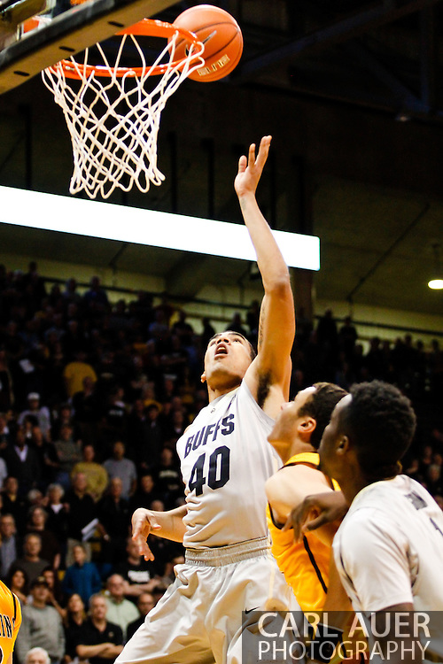 November 13th, 2013:  Colorado Buffaloes sophomore forward Josh Scott (40) attempts to tip a shot up in the first half of action in the NCAA Basketball game between the University of Wyoming Cowboys and the University of Colorado Buffaloes at the Coors Events Center in Boulder, Colorado