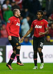 Man Utd Forward Wayne Rooney (ENG) limps as Midfielder Luis Antonio Valencia (ECU) comes over to him during the second half of the match - Photo mandatory by-line: Rogan Thomson/JMP - Tel: Mobile: 07966 386802 17/08/2013 - SPORT - FOOTBALL - Liberty Stadium, Swansea -  Swansea City V Manchester United - Barclays Premier League - First round of the 2013/14 season and the first league match for new Man Utd manager David Moyes.