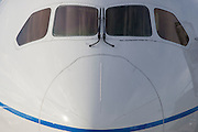 The nose of the Boeing-manufactured 787 Dreamliner (N787BX) at the Farnborough Airshow. On its first flight outside of the US during its testing programme, the newest airliner in the Boeing aviation family, has arrived at the air show for a few days of exhibitions to the aerospace-buying community and the trade press. Later the public will have the chance to see this jet up close too. The Boeing 787 Dreamliner is a long range, mid-sized, wide-body, twin-engine  jet airliner developed by Boeing Commercial Airplanes. It seats 210 to 330 passengers, depending on variant. Boeing states that it is the company's most fuel-efficient airliner and the world's first major airliner to use composite materials for most of its construction