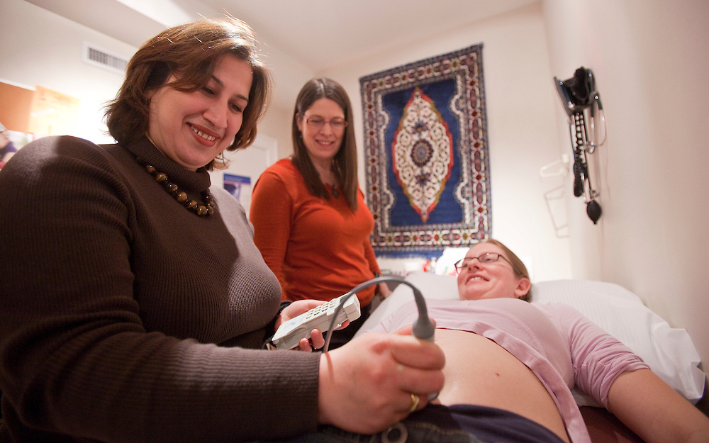London, Ontario ---10-02-16---  Midwife Mojgan Nadafi, left, and her colleague Janis Dalacker examine client Lynn Conforzi who is 19 weeks pregnant at Thames Valley Midwives in London, Ontario, February 16, 2010. Mojgan, who in Iran was a well regarded academic in midwifery with her masters degree had difficulty getting her qualifications recognized when she immigrated to Canada.<br /> GEOFF ROBINS The Globe and Mail