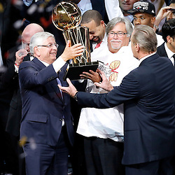 Jun 20, 2013; Miami, FL, USA; NBA commissioner David Stern present the Larry O'Brien Championship trophy to Miami Heat owner Micky Airison (center) and president Pat Riley after game seven in the 2013 NBA Finals at American Airlines Arena. Miami defeated the San Antonio Spurs 95-88 to win the NBA Championship. Mandatory Credit: Derick E. Hingle-USA TODAY Sports