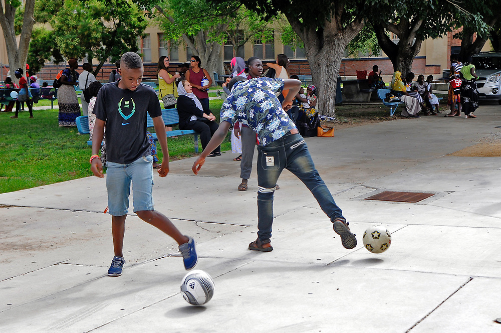 jt072817k/ a sec/jim thompson/    Paul Irankunda from Tanzania kicks around a soccer ball with other members of the students that went through the refugee summer school program at Highland High School.  Friday, July. 28, 2017. (Jim Thompson/Albuquerque Journal)