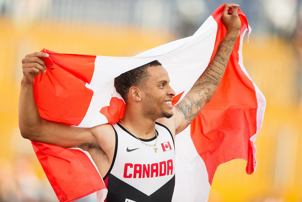 Andre De Grasse of Canada celebrates his gold medal win in the men's 200 metres at the 2015 Pan American Games at CIBC Athletics Stadium in Toronto, Canada, July 24,  2015.  AFP PHOTO/GEOFF ROBINS