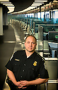 Customs agent at counter in Philadelphia international airport