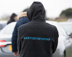 "© Licensed to London News Pictures. 06/01/2017. Huddersfield, UK. A man wearing a "" Justice for Yassar "" hoodie at the funeral of Yassar Yaqub at Hey Lane Cemmetary in Huddersfield, West Yorkshire. Yaqub, 28, from Huddersfield, was shot dead in a car stopped near junction 24 of the M62 as part of a planned police operation. Photo credit: Joel Goodman/LNP"