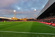 The winter sun sets on the Ealing Road Stand, Griffin Park, during the The FA Cup match between Brentford and Stoke City at Griffin Park, London, England on 4 January 2020.