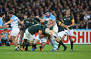 South Africa's Adriaan Strauss trying to break through during the Rugby World Cup Bronze Final match between South Africa and Argentina at the Queen Elizabeth II Olympic Park, London, United Kingdom on 30 October 2015. Photo by Matthew Redman.