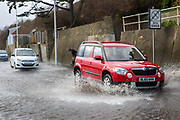 Cars driving down the A259 between Folkestone and Hythe is flooded on day two of Storm Ciara at high tide, Sandgate, Folkestone, Kent on the south coast of England,  Monday February 10, 2020, as Storm Ciara swept over the United Kingdom. Amber weather warnings were put into place by the MET office as gusts of up to 90mph and heavy rain swept across the UK. An amber warning from the MET office expects a powerful storm that will disrupt air, rail and sea links travel, cancel sports events, cut electrical power and damage property.  (photo by Andrew Aitchison / In pictures via Getty Images)