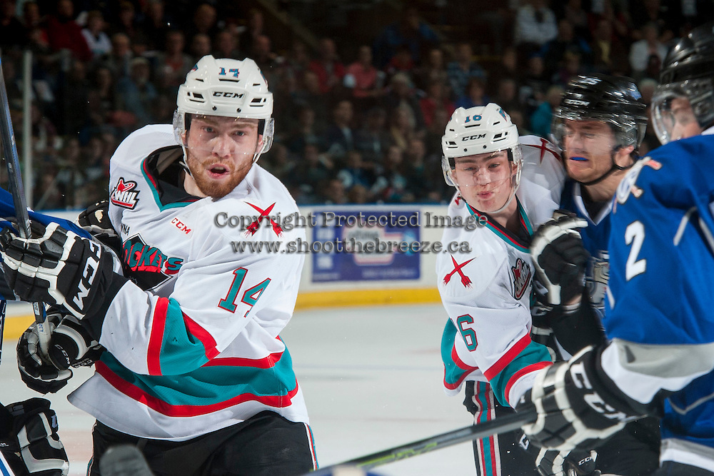 KELOWNA, CANADA - APRIL 14: Kole Lind #16 and Rourke Chartier #14 of Kelowna Rockets watch the puck after a shot against the Victoria Royals on April 14, 2016 at Prospera Place in Kelowna, British Columbia, Canada.  (Photo by Marissa Baecker/Shoot the Breeze)  *** Local Caption *** Rourke Chartier; Kole Lind;