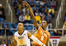 Jan 20, 2016; Morgantown, WV, USA; Texas Longhorns guard Tevin Mack (0) shoots a three pointer overWest Virginia Mountaineers guard Jevon Carter (2) during the first half at the WVU Coliseum. Mandatory Credit: Ben Queen-USA TODAY Sports