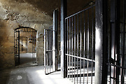 Prison cells with iron bars in the Chateau de Champlatreux, built 1751-57 by Jean-Michel Chevotet, Epinay-Champlatreux, Val-d'Oise, France. Image taken from the filming of 'Paris la ville a remonter le temps' written by Carlo de Boutiny and Alain Zenou, directed by Xavier Lefebvre, a Gedeon Programmes production. The chateau was listed as a Historic Monument in 1989. Picture by Manuel Cohen
