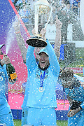 Eoin Morgan of England is sprayed with champaign by his team mates during the trophy presentation celebrations during the ICC Cricket World Cup 2019 Final match between New Zealand and England at Lord's Cricket Ground, St John's Wood, United Kingdom on 14 July 2019.